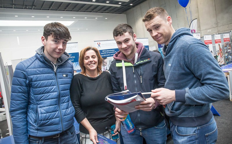 Eoin O'Halloran, Edmund O'Halloran and Alan McCarthy, Pobail Scoil na Trinoide, Youghal with tutor Clare Kearney during the Waterford Institute of Technology Schools' Open Day at the WIT Arena. On Saturday, 20 January, WIT is running another open day, the #StudyatWIT Open Day which will have information available on all courses available across WIT's schools of Lifelong Learning, Humanities, Engineering, Science & Computing, Health Sciences, Business. Picture: Pat Moore