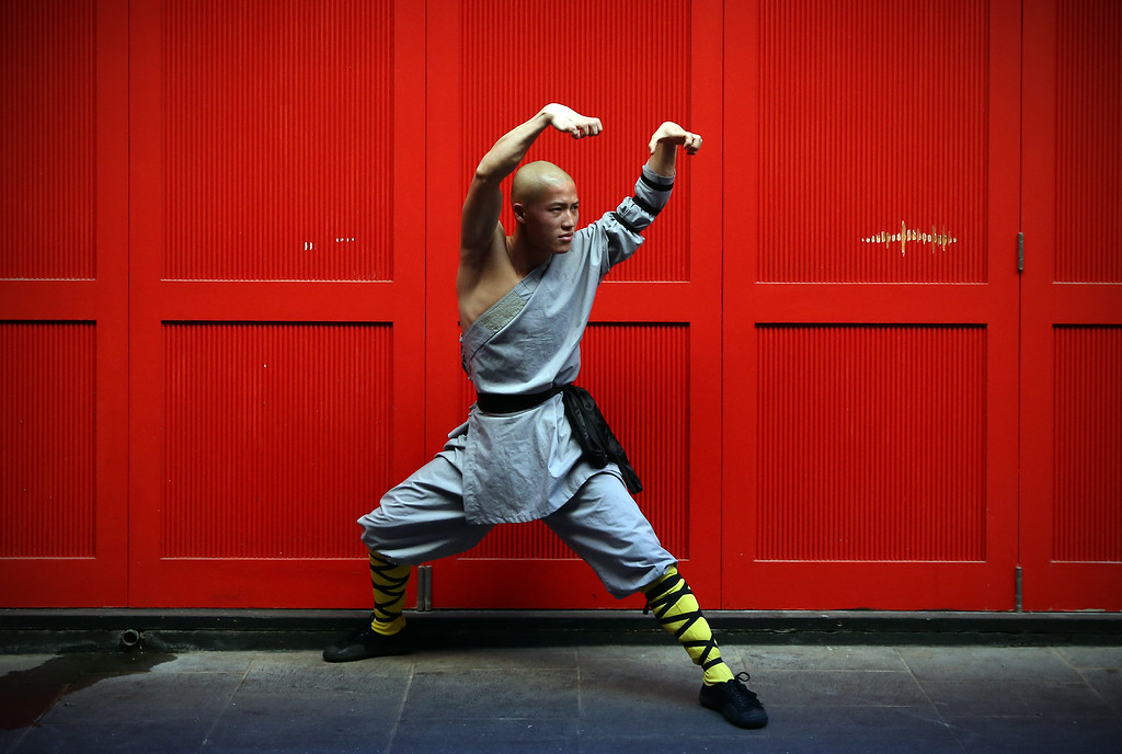 . LONDON, ENGLAND - FEBRUARY 23:  A Shaolin monk poses for a photograph in Chinatown on February 23, 2015 in London, England. The monks practice Shaolin Kung Fu which is believed to be the oldest institutionalised style of kung fu and are demonstrating their skills while in the UK.  (Photo by Carl Court/Getty Images)