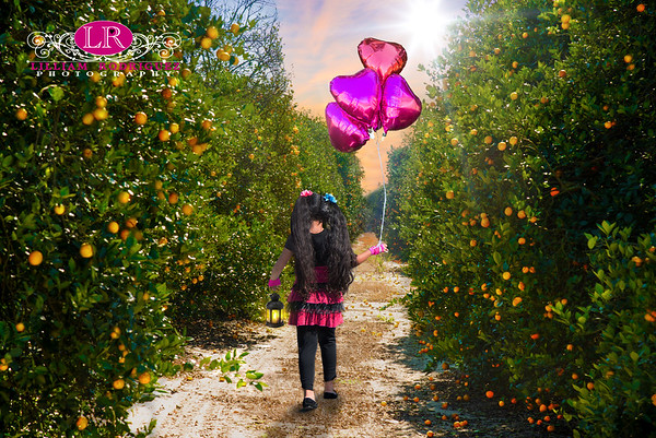 Little Girl In Orange Groves
