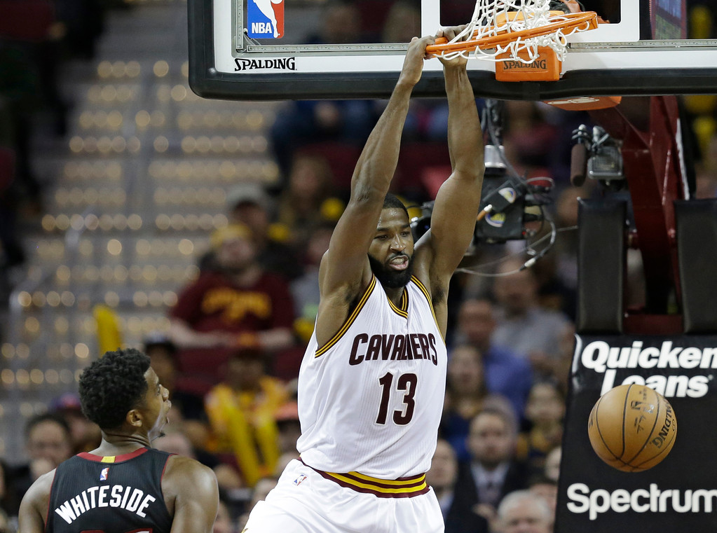 . Cleveland Cavaliers\' Tristan Thompson (13) dunks against Miami Heat\'s Hassan Whiteside (21) in the second half of an NBA basketball game, Monday, March 6, 2017, in Cleveland. The Heat won 106-98. (AP Photo/Tony Dejak)