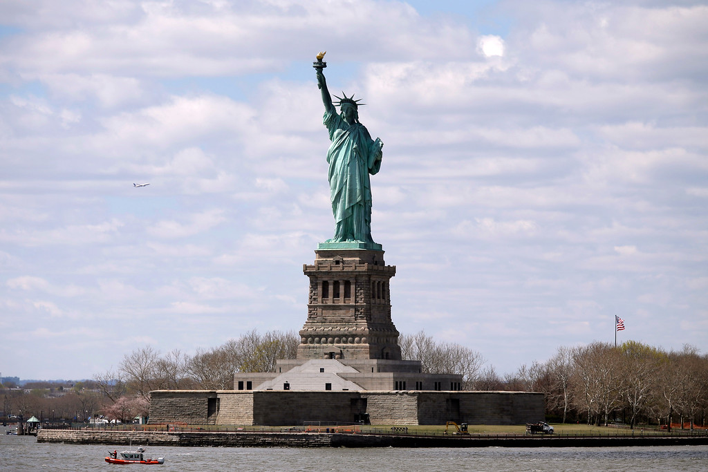 . A coast guard boat patrols the waters surrounding the Statue of Liberty,  Friday, April 24, 2015, in New York.   (AP Photo/Mary Altaffer)