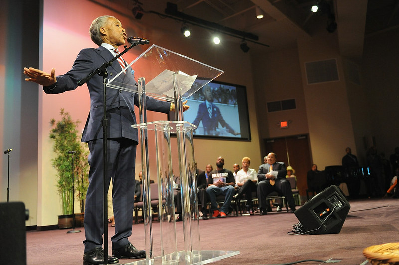 """. Al Sharpton speaks during a rally in support of Michael Brown Jr. and police brutality at Greater Grace Church in Ferguson, Missouri. The US Justice Department announced that a federal medical examiner would carry out a second autopsy on Brown\'s body, citing the case\'s \""""extraordinary circumstances.\"""" A first one has already been performed.  Michael B. Thomas/AFP/Getty Images"""