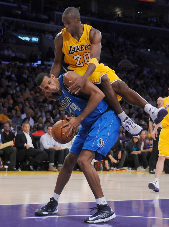 . Lakers Jodie Meeks fouls Dallas Brandan Wright in the 4th quarter. The Los Angeles Lakers lost to the Dallas Mavericks 99-91 in the opening game of the 2012-2013 NBA Season. Los Angeles, CA 10/30/2012 (photos by John McCoy/Staff Photographer)
