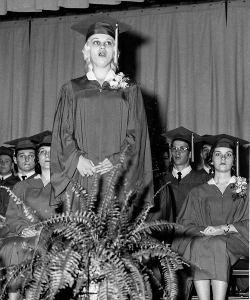 Left to right:  Back: Mesmerized graduates, Jim Bender, Lester Burket, Jackie Garland, John Wills, One of the Wilson twins Front: Some mouth breathing girl hogging the spotlight  (Actually that's Luci Sharer singing, as I recall very well, at graduation)