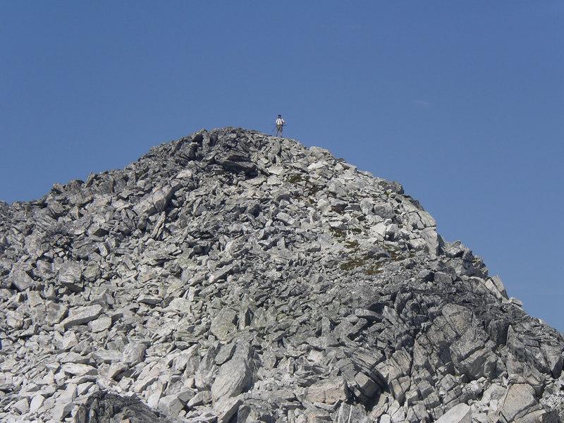 Scott climbs up a big pile of rocks.