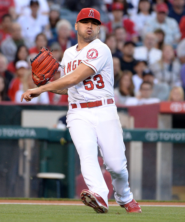 . Los Angeles Angels starting pitcher Hector Santiago (53) commits a throwing error on a ground ball by New York Yankees\' Brett Gardner (not pictured) in the first inning of a baseball game at Anaheim Stadium in Anaheim, Calif., on Wednesday, May 7, 2014.  (Keith Birmingham Pasadena Star-News)