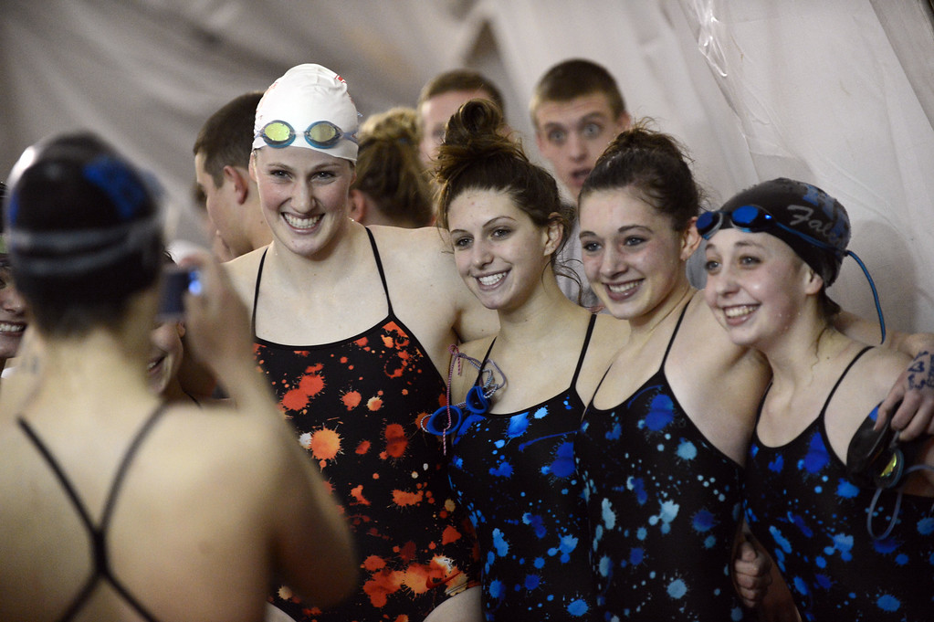 . Olympic gold medalist Missy Franklin of Regis Jesuit, second from left, takes picture with Highlands Ranch swimmers after the meet at Regis Jesuit swimming pool on Tuesday in  Aurora, CO, January 8, 2013.  Hyoung Chang, The Denver Post