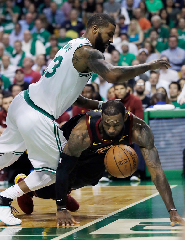 . Cleveland Cavaliers forward LeBron James (23) loses the ball out of bounds under defensive pressure from Boston Celtics forward Marcus Morris (13) during the first quarter of Game 5 of the NBA basketball Eastern Conference finals Wednesday, May 23, 2018, in Boston. (AP Photo/Charles Krupa)
