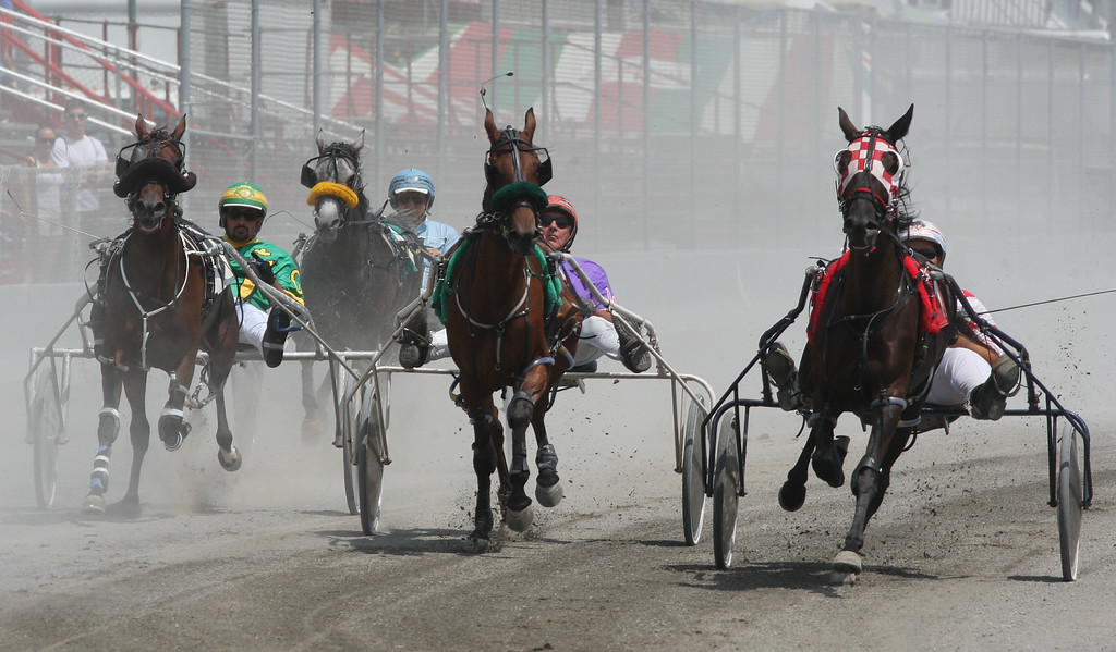 . Horses and drivers leave the start gate for harness racing at the Boonville Oneida County Fair on Tuesday, July 22, 2014 in Boonville. the fair runs through Sunday, July 27, 2014.  JOHN HAEGER-ONEIDA DAILY DISPATCH @ONEIDAPHOTO ON TWITTER