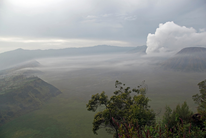 Shot of the crater lip of Mount Bromo against foggy sky