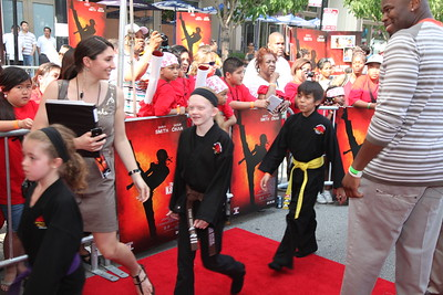 Kung Fu students accompany Jaden Smith and Jackie Chan to the red carpet for the Chicago screening of the Karate Kid at the AMC River East 21 in Chicago, IL,  USA on Wednesday 26, May 2010.