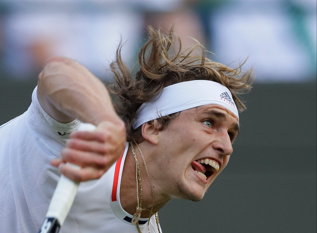 . Alexander Zverev of Germany serves to Taylor Fritz of the US during their men\'s singles match on the fourth day at the Wimbledon Tennis Championships in London, Thursday July 5, 2018. (AP Photo/Kirsty Wigglesworth)