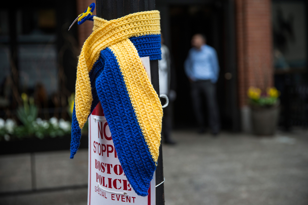 . A knitted tribute hangs on a street light along the course of the Boston Marathon on the one year anniversary of the 2013 Boston Marathon Bombing, on April 15, 2014 in Boston, Massachusetts. Last year, two pressure cooker bombs killed three and injured an estimated 264 others during the Boston marathon, on April 15, 2013.  (Photo by Andrew Burton/Getty Images)
