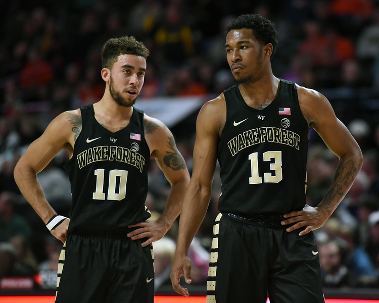 Mitch Wilbekin and Bryant Crawford chat on court.jpg