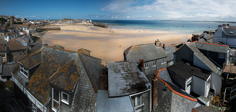 "St Ives (Cornish: Porth Ia, meaning ""St Ia's cove"") is a seaside town, civil parish and port in Cornwall. The town lies north of Penzance and west of Camborne on the coast of the Celtic Sea. In former times it was commercially dependent on fishing. The decline in fishing, however, caused a shift in commercial emphasis, and the town is now primarily a popular seaside resort,  St Ives, Cornwall, England, 2018"