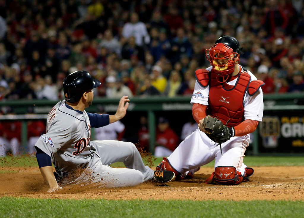 . Boston Red Sox catcher David Ross, right, tags out Detroit Tigers second baseman Omar Infante, left, at the plate in the fifth inning during Game 1 of the American League baseball championship series Saturday, Oct. 12, 2013, in Boston. (AP Photo/Matt Slocum)