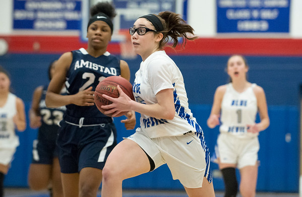 12/27/19 Wesley Bunnell | StaffrrPlainville girls basketball vs Amistad Academy on Friday night at Plainville High School. Jaida Vasquez (5).