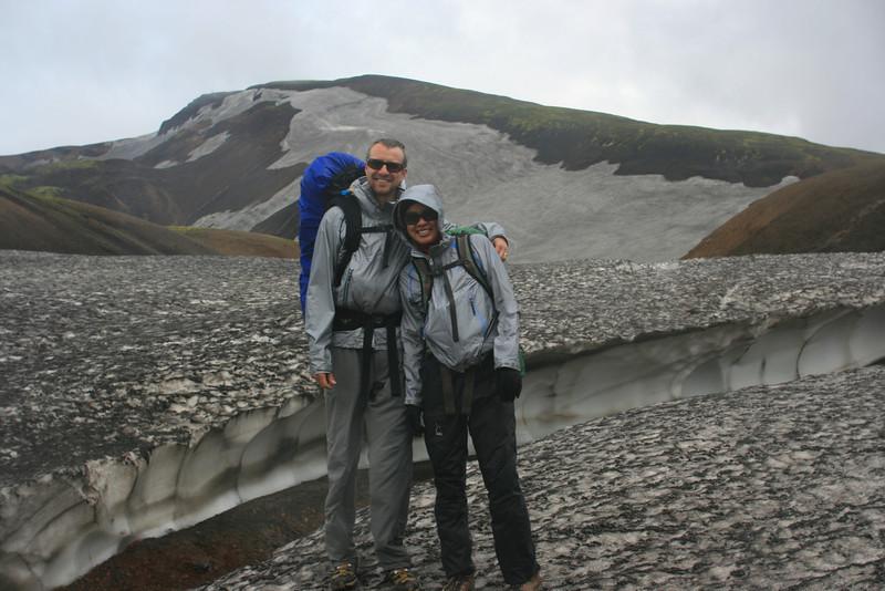 Shane & Jayna match the grey and black landscape.