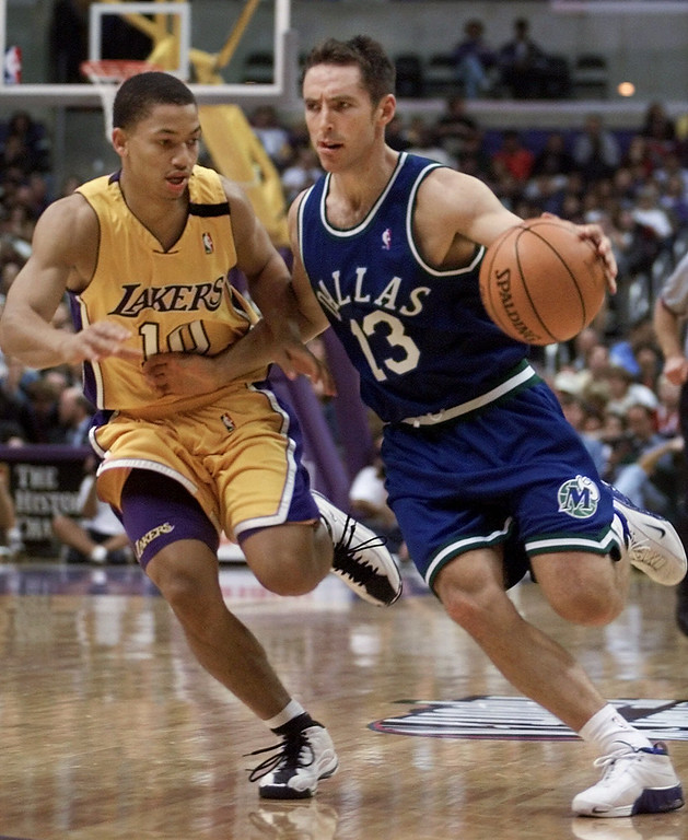 . Dallas Mavericks\' Steve Nash (13) dribbles down the court against Los Angeles\' Lakers Tyronn Lue (10) during the second quarter Sunday, Nov. 7, 1999, in Los Angeles.  The Lakers won 105-97.    (AP Photo/Kevork Djansezian)