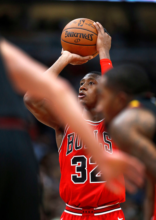 . Chicago Bulls\' Kris Dunn shoots a free throw during the second half of an NBA basketball game against the Cleveland Cavaliers Monday, Dec. 4, 2017, in Chicago. The Cavaliers won 113-91. (AP Photo/Charles Rex Arbogast)