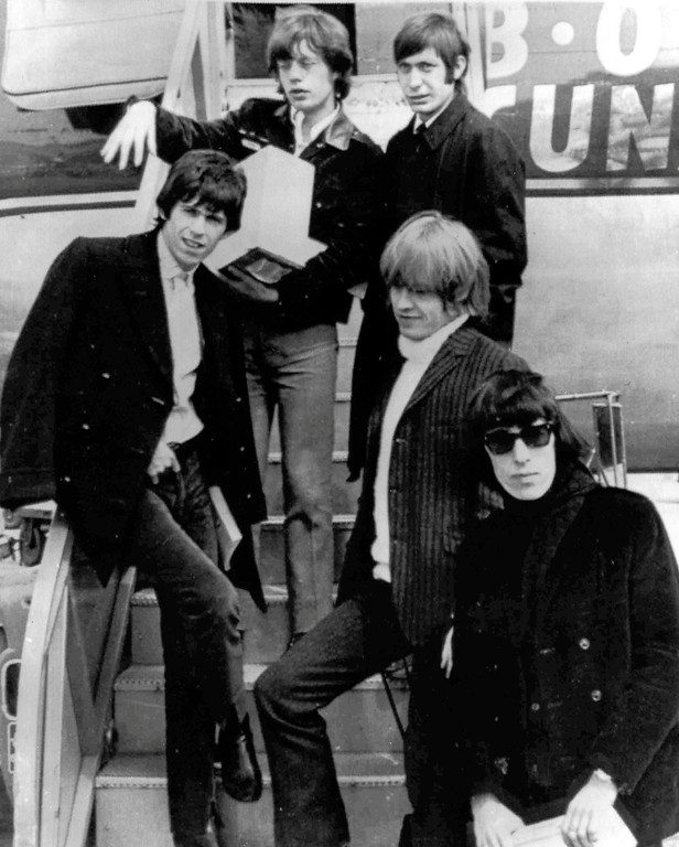 . In this April 22, 1965 file photo, British rock and roll group, The Rolling Stones, arrive at Montreal Airport. They are Mick Jagger, top left, Charlie Watts, top right, Keith Richards, middle left, Brian Jones, middle right, and Bill Wyman. (AP Photo, File)