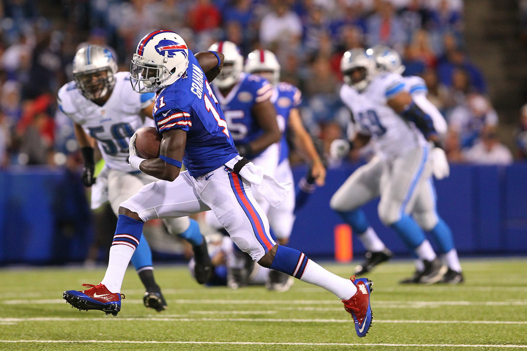 . Buffalo Bills wide receiver T.J. Graham (11) runs with the ball against the Detroit Lions during the second half of a preseason NFL football game, Thursday, Aug. 28, 2014, in Orchard Park, N.Y. (AP Photo/Bill Wippert)