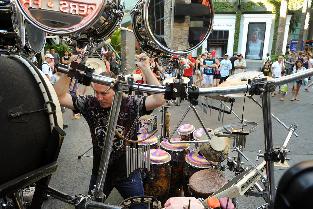 . C.G. Ryche plays an assortment of drums as part of the street performer series at Universal CityWalk. Friday, June 28, 2013. (Michael Owen Baker/L.A. Daily News)