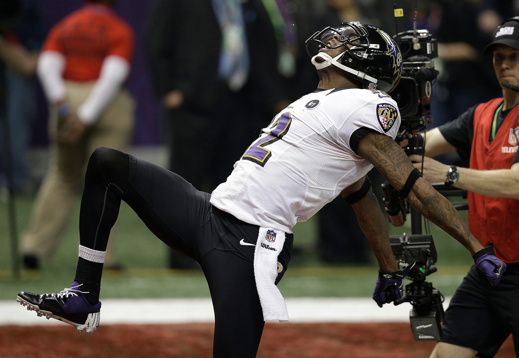 . Baltimore Ravens wide receiver Jacoby Jones (12) celebrates after returning a kickoff for a 108-yard touchdown against the San Francisco 49ers during the second half of the NFL Super Bowl XLVII football game, Sunday, Feb. 3, 2013, in New Orleans.(AP Photo/Elaine Thompson)