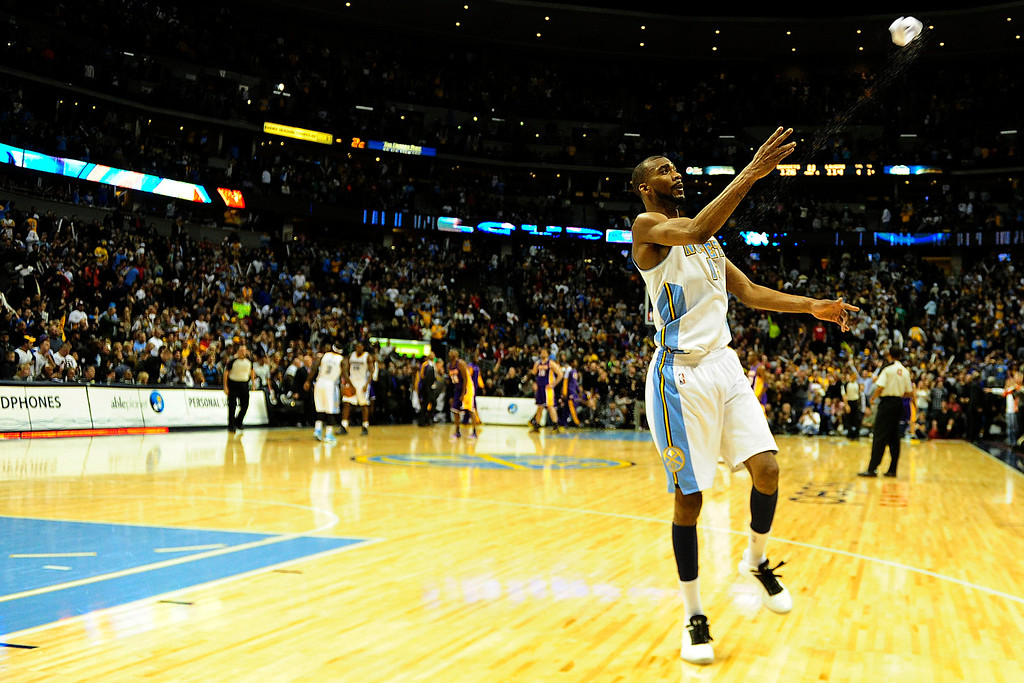 . Denver Nuggets small forward Corey Brewer (13) throws his headband into the stands following the Nuggets\' 126-114 win over the Los Angeles Lakers at the Pepsi Center on Wednesday, December 26, 2012. AAron Ontiveroz, The Denver Post