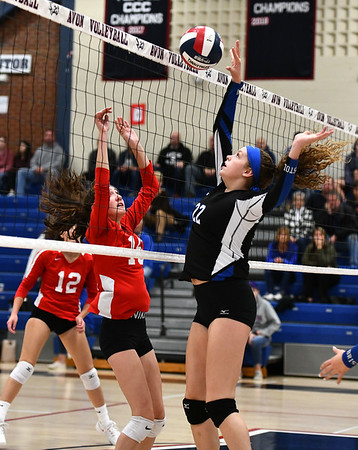 11/7/2019 Mike Orazzi | StaffrBristol Eastern's Hannah Webber (22) Conard High School's Isabella Pincince (15) during the CCC girls volleyball tournament at Avon High School on Thursday. r
