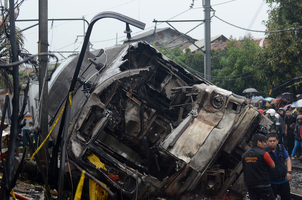 . A general view of the train wreck on December 9, 2013 on the outskirts Jakarta, Indonesia. A commuter train collided with a vehicle reportedly carrying liquefied gas canisters at around 11:20am local time. At least five people are reported dead.  (Photo by Nurcholis Anhari Lubis/Getty Images)