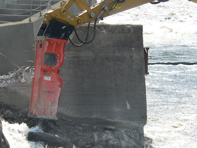 NPK GH23 hydraulic hammer on CAT excavator Maine Dam Demolition (4).JPG