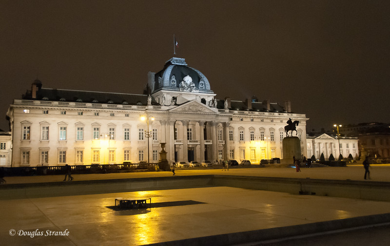 The Ecole Militaire, a military training facility, seen at night from the Champs de Mars