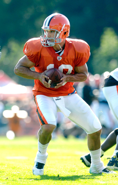 . News-Herald file Browns quarterback Brady Quinn looks to hand off during the first day of training camp Saturday in Berea.