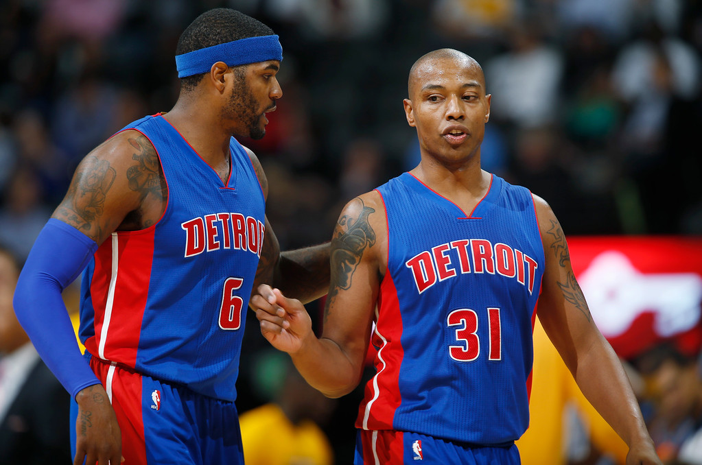 . Detroit Pistons forwards Josh Smith, left, and Caron Butler confer during a time out against the Denver Nuggets in the fourth quarter of the Nuggets\' 89-79 victory in an NBA basketball game in Denver on Wednesday, Oct. 29, 2014. (AP Photo/David Zalubowski)