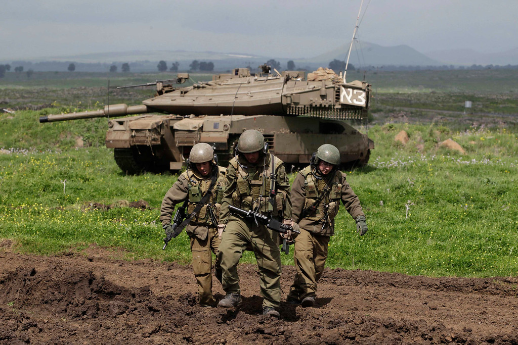 . Israeli soldiers carry a mock victim on a stretcher as they take part in a drill in the Golan Heights, near Israel\'s border with Syria March 5, 2013. Israel captured the Golan Heights from Syria in the 1967 Middle East war and annexed the territory in 1981, a move not recognised internationally. REUTERS/Baz Ratner