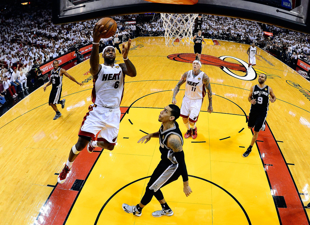 . LeBron James #6 of the Miami Heat goes up for a shot against Danny Green #4 of the San Antonio Spurs in the second half during Game Two of the 2013 NBA Finals at AmericanAirlines Arena on June 9, 2013 in Miami, Florida.   (Photo by Larry W. Smith/Pool/Getty Images)