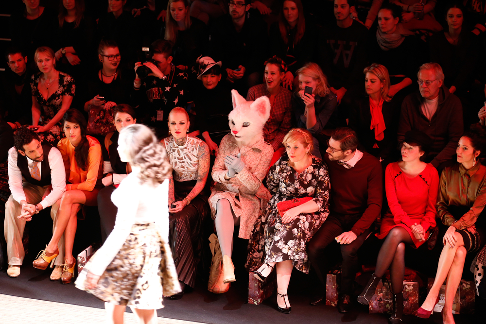 . (L-R) Massimo Sinato, Rebecca Mir, Lexy Hill, Maite Kelly, Florent Raimond, guest, Johanna Klum attend the Rebekka Ruetz show during Mercedes-Benz Fashion Week Autumn/Winter 2014/15 at Brandenburg Gate on January 14, 2014 in Berlin, Germany.  (Photo by Andreas Rentz/Getty Images for IMG)
