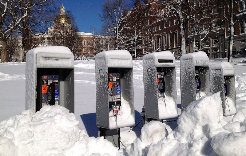 . Piles of snow surround a bank of pay phones on Boston Common in front of the Statehouse, Sunday, Feb. 10, 2013, after more than two feet of snow blanketed the region from a storm that ended Saturday. (AP Photo/Cara Rubinsky)