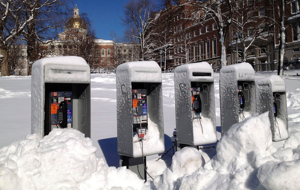 Description of . Piles of snow surround a bank of pay phones on Boston Common in front of the Statehouse, Sunday, Feb. 10, 2013, after more than two feet of snow blanketed the region from a storm that ended Saturday. (AP Photo/Cara Rubinsky)