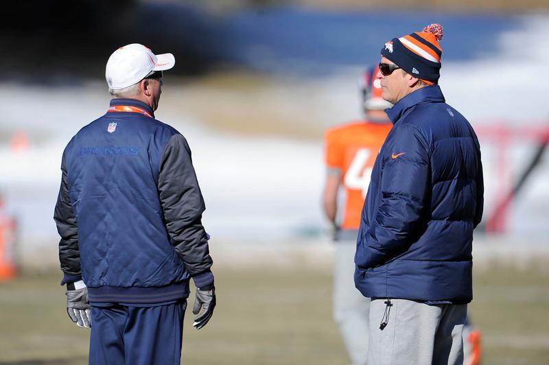 . Denver Broncos head coach John Fox and defensive coach jack Del Rio talk during practice Wednesday, January 2, 2013 at Dove Valley.  John Leyba, The Denver Post