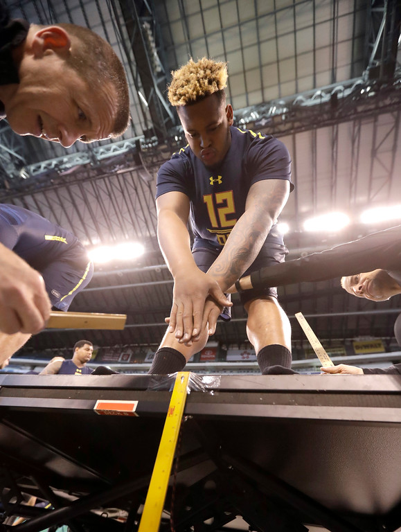 . Temple offensive lineman Dion Dawkins is measured for flexibility at the NFL football scouting combine Friday, March 3, 2017, in Indianapolis. (AP Photo/David J. Phillip)