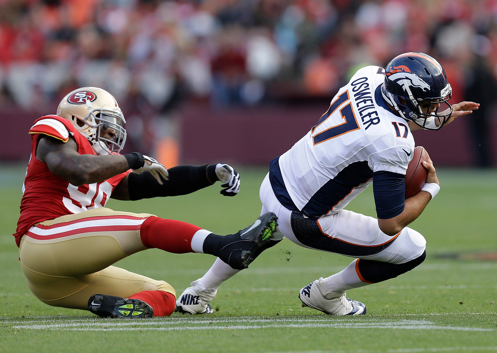 . Denver Broncos quarterback Brock Osweiler, right, gets past San Francisco 49ers linebacker Parys Haralson, left, during the second quarter of an NFL preseason football game on Thursday, Aug. 8, 2013, in San Francisco. (AP Photo/Ben Margot)