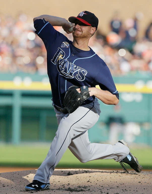 . Tampa Bay Rays starting pitcher Alex Cobb throws during the first inning of a baseball game against the Detroit Tigers in Detroit, Friday, July 4, 2014. (AP Photo/Carlos Osorio)