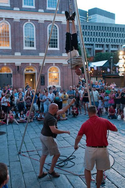 Houdini-esque street performance.