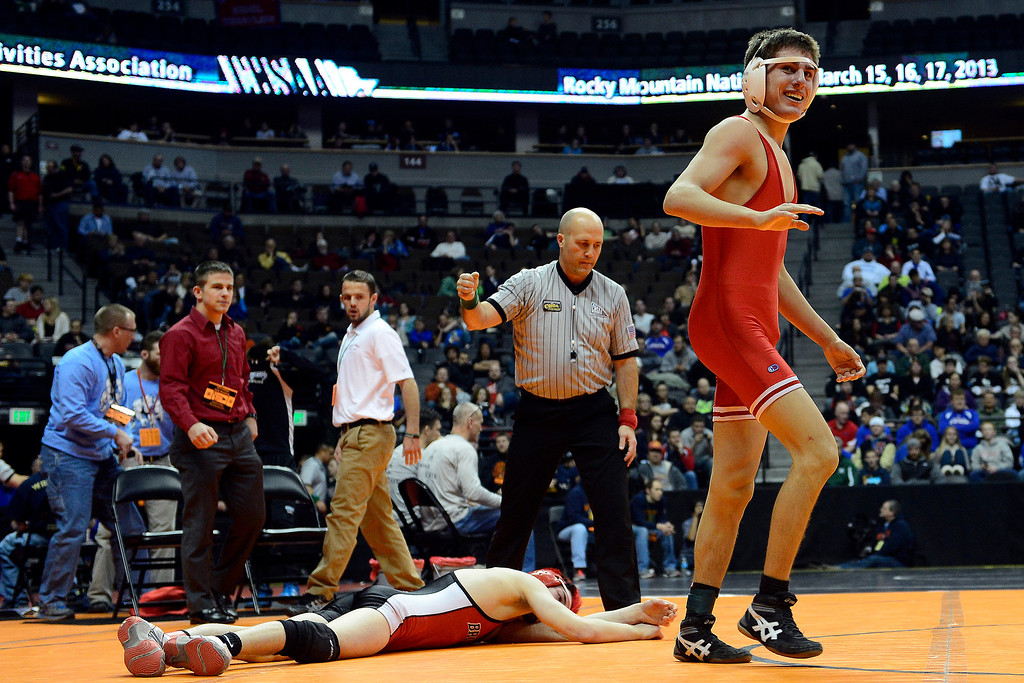 . DENVER, CO - FEBRUARY 21:  Regis Jesuit\'s Josh Redman celebrates a 9-7 overtime win against Brighton\'s Eric Yamaguchi during the Colorado State High School Wrestling Championships. The state finals will run through Saturday evening at the Pepsi Center. (Photo by AAron Ontiveroz/The Denver Post)
