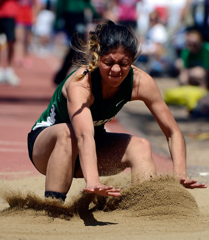 . LITTLETON, CO. - APRIL 27TH: Deyja Enriquez, lands in the sand pit in the girls triple jump competition during the Liberty Bell Track Meet at Littleton Public Schools Stadium Saturday, April 27th, 2013. (Photo By Andy Cross/The Denver Post)