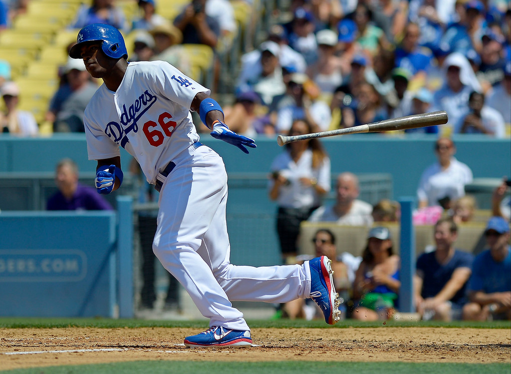 . Los Angeles Dodgers\' Yasiel Puig hits a single during the fifth inning of a baseball game against the Colorado Rockies, Sunday, July 14, 2013, in Los Angeles. (AP Photo/Mark J. Terrill)