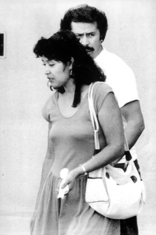 . Angelina de la Torre and her husband Manuel, leave the Hollenbeck police station in Los Angeles after being questioned in the Night Stalker case.  (Daily News file photo)