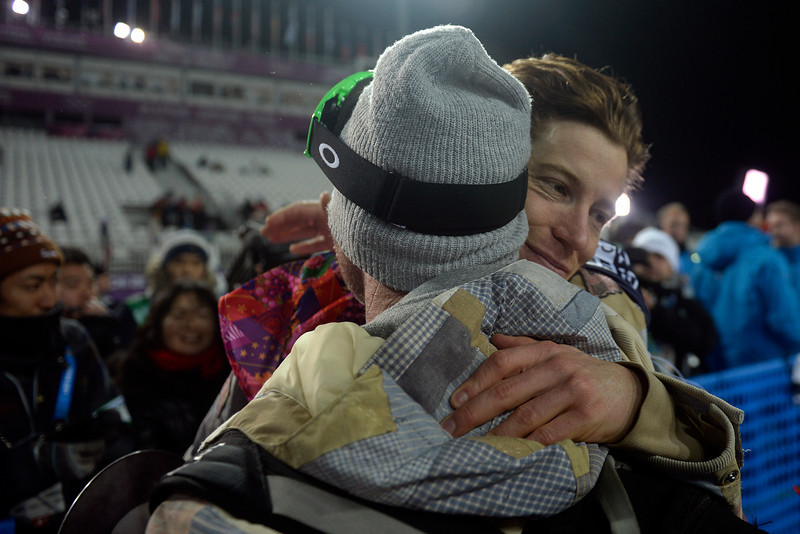 . Two-time defending gold medalist Shaun White hugs his longtime trainer Bud Keene after finishing fourth in the men\'s snowboard halfpipe final. Sochi 2014 Winter Olympics on Tuesday, February 11, 2014. (Photo by AAron Ontiveroz/The Denver Post)